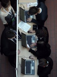 Przedsiębiorcy przy komputerach
